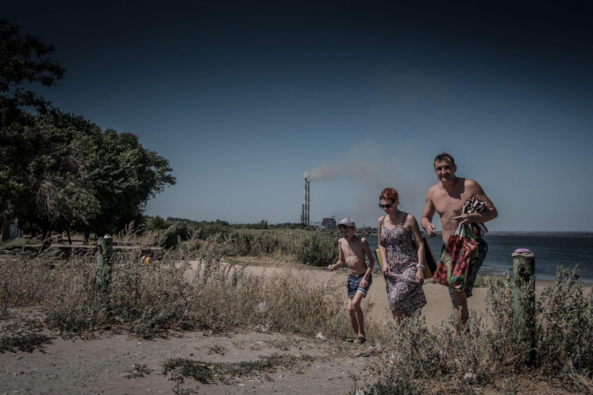 Ukraines take a sunbath close to a power plant